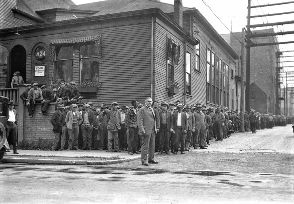 Andrew Roddan getting ready to open-air preach to a line of men waiting to get food at the First United Church in Vancouver
