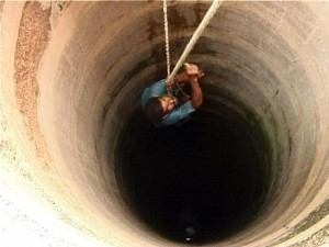 Man going down a well